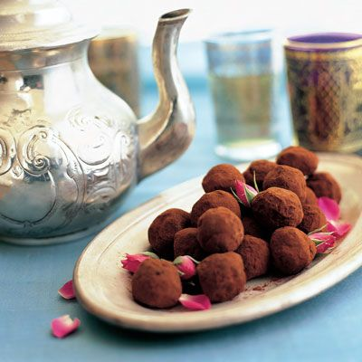"<p>These decadent tea-infused chocolates are far easier to make than you might think and are a thoughtful and impressive gift for guests. The recipe makes two dozen, so make sure you pace yourself.</p> <p><strong>Recipe: <a href=""http://www.delish.com/recipefinder/black-currant-chocolate-truffles-desserts"" target=""_blank"">Black Currant Tea-Chocolate Truffles</a></strong></p>"