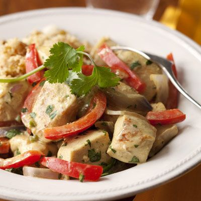 <p>Serving a simple almond-raisin couscous on the side rounds out this spicy dish. </p>