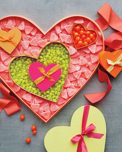"<p>Present freshly baked treats and Valentine's Day candy in beautifully embellished boxes, bags, and containers.</p>  <p>You can make these boxes in many sizes so they'll nest. </p>  <p><strong><a href=""http://www.marthastewart.com/873647/valentine-candy-boxes?xsc=synd_delish"" target=""_blank"">How to Make the Valentine Candy Boxes</a></strong></p>"