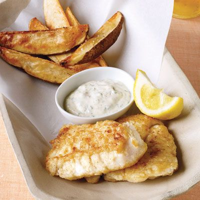 "<p>Here's a way to get crispy fish and potatoes without lots of oil. To keep the fat profile low, serve with Low-Fat Tartar Sauce made with light mayonnaise and nonfat yogurt or simply sprinkle with malt vinegar.</p><p><b>Recipe: </b><a href=""http://www.delish.com/recipefinder/light-fish-chips-ghk?click=recipe_sr"" ><b>Lightened-Up Fish and Chips</b></a></p>"