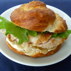 <p>Pretzel buns are a trendy way to remix your usual lunchtime sandwich.</p> <p><em>To make:</em><br /> 1. Preheat oven to 300 degrees F. On parchment-lined rimmed baking sheet, sprinkle 1/2 cup baking soda. Bake baking soda 45 minutes. Remove from oven; let cool.<br />     2. Increase oven to 450 degrees F. In 4-quart saucepot, heat 8 cups water until hot; whisk in baked baking soda (try to avoid touching the baked baking soda, as it could irritate your skin). Line baking sheet with new sheet parchment.<br />     3. Roll and stretch a large handful of dough into 12-inch-long rope. Twist ends and press ends into center of rope to form fat pretzel shape. Repeat with remaining dough.<br />     4. Gently lower into hot water as many pretzels as will comfortably fit into pot. Let soak for 30 seconds, flipping occasionally. Remove pretzels with large slotted spoon and place on parchment-lined baking sheet. Repeat with remaining pretzels.<br />    5. Brush tops of soaked pretzels with beaten egg yolk and sprinkle with coarse sea salt. Bake 15 to 20 minutes or until very dark brown. Slice in half and use for chicken sandwiches or burgers. </p>