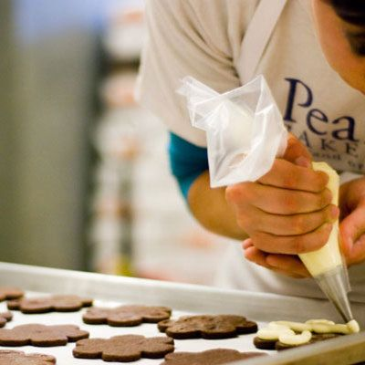 "<p>Portland's <a href=""http://www.pearlbakery.com/"" target=""_blank"">Pearl Bakery</a> started small in 1997, but soon gained national acclaim for their breads and pastries. The bakery continues to make their baked goods by hand, using organic, local ingredients whenever possible. Pugliese, their signature bread, is holey with a chewy crust. The bakery uses several leavening methods, which is why you'll find a wide range of breads, including wheat levain, paesanao, fig anise panini, multigrain boule, batard, and Pullman loaf. Their pastry selection features breakfast items like brioche, cornmeal pound cake, Irish soda bread, and chocolate croissants, small treats ranging from snickerdoodles to Parisian macarons, and larger treats like traditional layer cakes and tarts. Pearl Bakery also sells handmade bonbons and chocolate bars made from single-origin chocolate. Quite an impressive array! </p>"