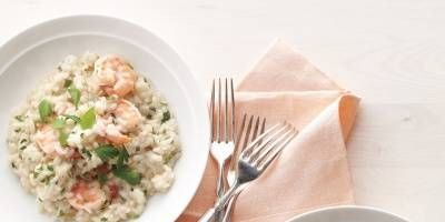 """<p>Creamy rice with shrimp and a hint of garlic and Parmesan cheese makes the perfect, easy, weeknight meal. To make it vegetarian, swap vegetable broth for the chicken broth and replace the shrimp with roasted vegetables like mushrooms or cherry tomatoes. </p> <p><strong>Recipe: <a href=""""http://www.delish.com/recipefinder/shrimp-herb-risotto-recipe-mslo0214"""" target=""""_blank"""">Shrimp-and-Herb Risotto</a></strong></p>"""