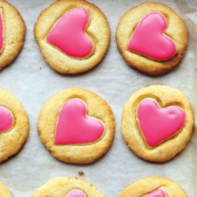 <p>These crispy cornmeal cookies make the prettiest treat for Valentine's Day. A heart-shaped cookie cutter is pressed into each round just to create an impression. Once baked, the hearts are spread with pink glaze.</p>