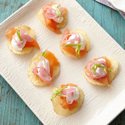 "<p>These small bites are big on flavor: crunchy potato chips are topped with smoked salmon, sour cream, pickled shallots, and fresh tarragon. This effortless appetizer is sure to impress.</p><p><strong>Recipe:</strong> <a href=""http://www.delish.com/recipefinder/smoked-salmon-bites-recipe-ghk0414""><strong>Smoked Salmon Bites</strong></a></p>"