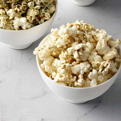 this delicious, tangy popcorn is coated in an ingenious mix of pickling spices, like coriander seeds and dill weed       recipe  dill pickle popcorn