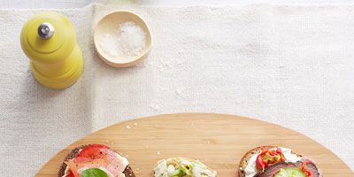 """<p>A more gourmet take on cream cheese and lox, these tartines include crumbled goat cheese and slices of fresh tomatoes.</p> <p><b>Recipe: <a href=""""http://www.delish.com/recipefinder/smoked-salmon-tomato-tartines-recipe-ghk0812?click=recipe_sr""""> Smoked Salmon and Tomato Tartines</a></b></p>"""