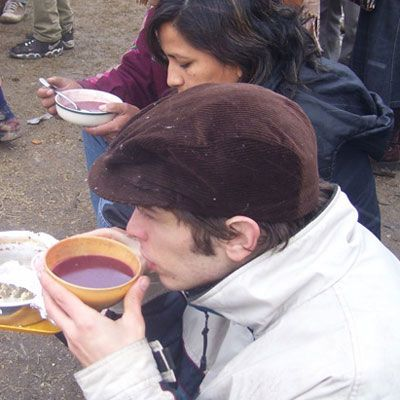 """<p>A typical Bolivian drink, api morado is a brew of purple corn and pineapple with added aromatic spices like cinnamon, cloves, and orange zest. The drink is so thick it can also be eaten with a spoon, and is usually served for <a href=""""http://www.southamericaliving.com/traditional-breakfast-foods-in-bolivia/"""" target=""""_blank"""">breakfast</a>. There is also a white version of the beverage, api blanco, which is made from milk, sugar, cinnamon, and white corn.</p>"""