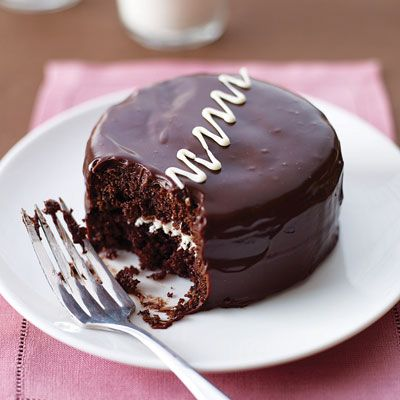 """<p>Satisfy your sweet tooth with these decadent, individually sized cream-filled cakes. The cake layers feature cocoa powder and sour cream — to keep it extra moist — while the cream is subtly enhanced with melted white chocolate.</p><p><b>Recipe: </b><a href=""""http://www.delish.com/recipefinder/chocolate-cream-cakes"""" target=""""_blank""""><b>Chocolate Cream Cakes</b></a></p>"""