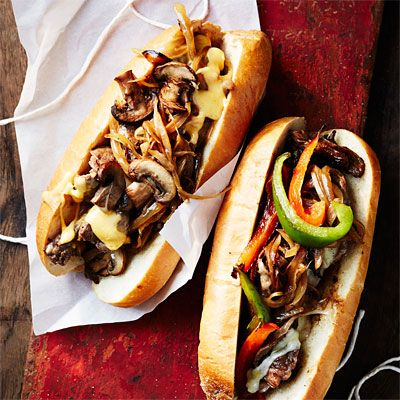 """<p>Piping hot and smothered in onions and peppers, when it comes to ballpark sandwiches, you can't beat the Philly cheesesteak. Pile on the toppings, after all, you don't have to worry about spilling when you're at home.</p><p><strong>Recipe: <a href=""""http://www.delish.com/recipefinder/philly-cheesesteak-recipe-wdy0314"""" target=""""_blank"""">Philly Cheesesteak</a></strong></p>"""