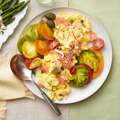 "<p>For this fast feed-the-family dish, just soft-scramble a dozen eggs with savory bagel-shop staples — smoked salmon and cream cheese. Sprinkle with onions and capers and serve family-style with sliced tomatoes so the whole family can come together and enjoy.</p> <p><strong>Recipe: <a href=""http://www.delish.com/recipefinder/lox-scrambled-eggs-recipe-ghk0512"" target=""_blank"">Lox Scrambled Eggs</a></strong></p>"
