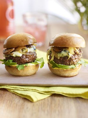 """<p>With a topping of sautéed mushrooms, onions, and rich blue cheese, these little burgers are a flavorful addition to your next barbecue or cookout spread. </p><p><strong>Recipe:</strong> <a href=""""http://www.delish.com/recipefinder/steakhouse-sliders-mushrooms-blue-cheese-recipe-rbk0811""""><strong>Steak-House Sliders with Mushrooms and Blue Cheese</strong></a></p>"""
