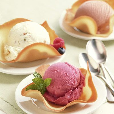 """<p>These elegant dessert shells are your entertaining secret weapon: They're surprisingly easy to whip up, and you can keep some on hand for last-minute guests. Wrap well and store for up to a week. Fill with ice cream, sorbet, or lemon curd and fresh fruit.</p> <p><strong>Recipe: <a href=""""http://www.delish.com/recipefinder/tulipes-cookies-raspberry-sorbet-ghk"""" target=""""_blank"""">Tulipes</a></strong></p>"""