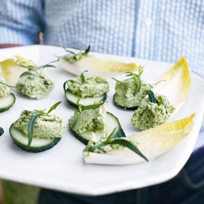 "<p>Crisp cucumbers and endive are topped with a healthy, flavorful mixture of edamame, smooth ricotta cheese, and caramelized shallot to make this light, elegant appetizer.</p><p><b>Recipe: </b><a href=""http://www.delish.com/recipefinder/edamame-ricotta-spread-endive-cucumber-recipe-clv0711""><b>Edamame-Ricotta Spread on Endive and Cucumber</b></a></p>"
