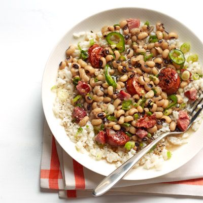 "<p>Smoked sausage and jalapeño really spice up the peas and rice in this version of the Southern New Year's favorite.</p> <p><strong>Recipe: <a href=""http://www.delish.com/recipefinder/louisiana-hoppin-john-recipe-wdy0113"" target=""_blank"">Louisiana Hoppin' John</a></strong></p>"