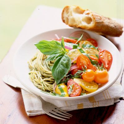 "<p>A vibrant cherry tomato salad tops this traditional pesto pasta dish.</p> <p><strong>Recipe:</strong> <a href=""http://www.delish.com/recipefinder/thin-spaghetti-pesto-tomatoes-656"" target=""_blank""><strong>Thin Spaghetti with Pesto and Tomatoes</strong></a></p>"
