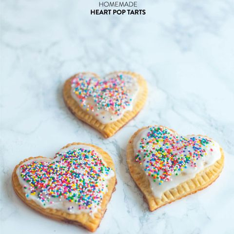 "a <br /><br /> Get the recipe from <a href=""http://www.stylemepretty.com/living/2014/02/14/homemade-heart-pop-tarts/"" target=""_blank"">Style Me Pretty</a>"