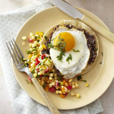 "<p>Try this new spin on tostadas served with a tomato-zucchini salsa and fried eggs on top.</p> <p><strong>Recipe:</strong> <a href=""http://www.delish.com/recipefinder/tostada-stacks-recipe-ghk0811"" target=""_blank""><strong>Tostada Stacks</strong></a></p>"