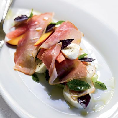"<p>Chef Andy Glover of Mission Estate Winery used smoked pork, but prosciutto is also tasty.</p>  <p><strong>Recipe:</strong> <a href=""http://www.delish.com/recipefinder/melon-peach-salad-prosciutto-mozzarella-recipe""><strong>Melon and Peach Salad with Prosciutto and Mozzarella</strong></a></p>"