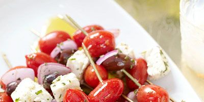 """<p>Skewers stacked with classic Greek salad ingredients — tomatoes, olives, and feta cheese — are perfect for a summer barbecue menu.</p><br /> <p><b>Recipe: <a href=""""http://www.delish.com/recipefinder/skewered-greek-salad-recipe"""" target=""""_blank"""">Skewered Greek Salad</a></b></p>"""