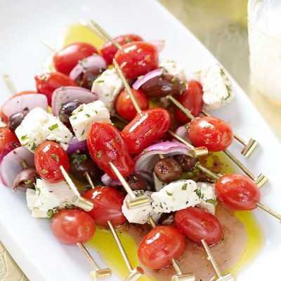 "<p>Skewers stacked with classic Greek salad ingredients — tomatoes, olives, and feta cheese — are perfect for a summer barbecue menu.</p><br /> <p><b>Recipe: <a href=""http://www.delish.com/recipefinder/skewered-greek-salad-recipe"" target=""_blank"">Skewered Greek Salad</a></b></p>"
