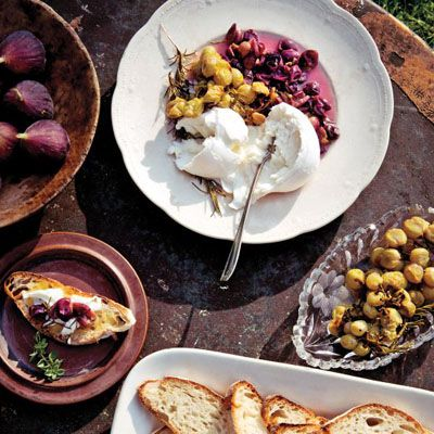 """<p>Burrata cheese, a buttery-tasting blend of mozzarella and cream, is available at Italian markets, cheese shops, and some supermarkets. </p> <p><strong>Recipe: <a href=""""http://www.delish.com/recipefinder/roasted-grape-burrata-crostini-recipe-mslo0814"""" target=""""_blank"""">Roasted Grape and Burrata Crostini</a></strong></p>"""