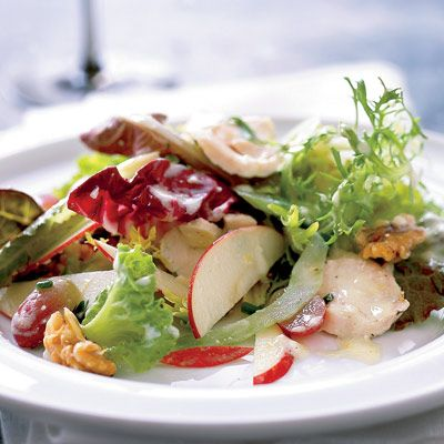 """<b>At the restaurant: $15 per person</b><br /> Sullivan brines poultry before roasting it, then tosses it with little gem lettuce, pickled grapes, and candied walnuts. <br /><br /> <b>At home: $5 per person</b><br /> A streamlined list of ingredients lowers the cost: This recipe calls for about half the ingredients.<br /><br /><b>Recipe:</b> <a href=""""/recipefinder/waldorf-chicken-salad-recipe""""target=""""_new"""">Waldorf Chicken Salad</a>"""