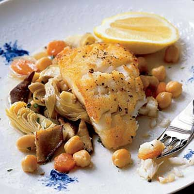 """<b>At the restaurant: $29 per person</b> <br />This recipe is based on <i>barigoule</i>, a Provençal dish of artichokes, mushrooms, and oil. Sullivan prepares it with baby artichokes and chanterelles. <br /><br /> <b>At home: $8 per person</b><br /> Make the dish with frozen artichokes and shiitake mushrooms, which are less pricey than chanterelles.<br /><br /> <b>Recipe:</b> <a href=""""/recipefinder/cod-artichokes-chickpeas-recipe""""target=""""_new"""">Cod with Artichokes and Chickpeas</a>"""