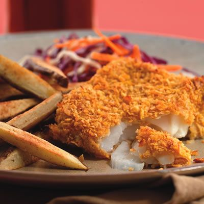 """<p>Fish and chips are traditionally sold wrapped in paper to soak up all the grease — not a good sign. To cut the calories in half and reduce the fat, we coat the delicate fish in a crispy cornflake crust and then bake it along with sliced potatoes.</p><br /><p><b>Recipe: </b><a href=""""/recipefinder/oven-fried-fish-chips-recipe-6534"""" target=""""_blank""""><b>Oven-Fried Fish and Chips</b></a></p>"""