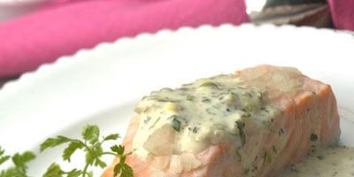"""Baking salmon fillets, covered, with a little wine and some shallots produces moist, succulent results as long as you remember the two cardinal rules of fish cookery: choose only the freshest fish and don't overcook it.<br /><br /><b>Recipe:</b> <a href=""""/recipefinder/oven-poached-salmon-fillets-recipe-5720""""target=""""_new"""">Oven-Poached Salmon Fillets</a>"""