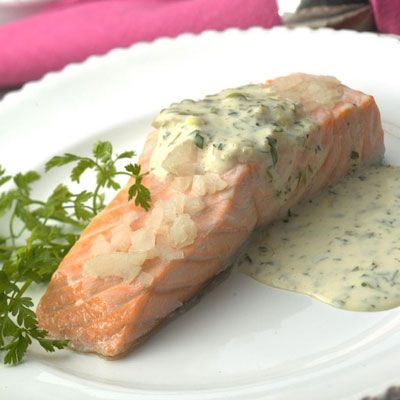 "Baking salmon fillets, covered, with a little wine and some shallots produces moist, succulent results as long as you remember the two cardinal rules of fish cookery: choose only the freshest fish and don't overcook it.<br /><br /><b>Recipe:</b> <a href=""/recipefinder/oven-poached-salmon-fillets-recipe-5720""target=""_new"">Oven-Poached Salmon Fillets</a>"