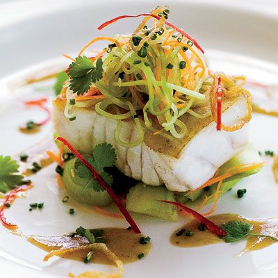 """A simple salad of julienned cucumbers and carrots tossed with a soy-mustard dressing makes this light fish dish incredibly vibrant.<br /><br /> <b>Recipe: <a href=""""/recipefinder/grouper-cucumber-salad-soy-mustard-dressing-recipe""""target=""""_new"""">Grouper with Cucumber Salad and Soy-Mustard Dressing</a></b>"""