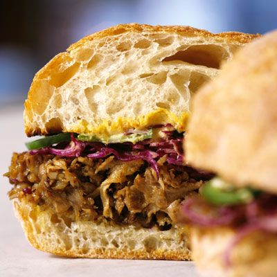 """<p>This sandwich from Tom Colicchio has its origin in pork barbecue, which is often served with coleslaw. The cabbage in the sandwich — a nod to that side of slaw — is seasoned with olive oil and red wine vinegar. It is assertive and acidic, balancing the richness of the pork, while the jalapeños add a nice kick.</p><br /><b>Recipe:</b> <a href=""""/recipefinder/slow-roasted-pork-red-cabbage-jalapenos-mustard-recipe"""" target=""""_blank""""><b>Slow-Roasted Pork with Red Cabbage, Jalapeños, and Mustard</b></a>"""