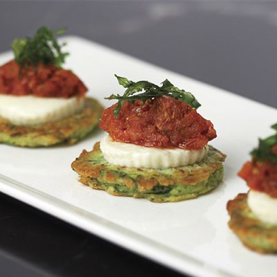 Zucchini Fritters with Fresh Buffalo Mozzarella, Stewed Grape Tomatoes, and Micro Basil from the chefs at Morrell's Wine Bar and Café in Rockefeller Center.