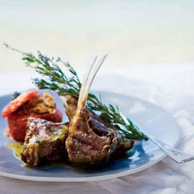 "Chef <a href=""/cooking-shows/food-tv/greek-easter-recipes-celebrity-chef"" target=""_blank"">Michael Psilakis</a> dresses these luscious lamb chops with ladolemono, a supersimple Greek sauce of lemon juice and olive oil. The sauce is often spooned over fish, but it's delicious on meat and vegetables, too. ""This is real Greek cooking,"" he says. Here the lamb chops are served alongside <a href=""/recipefinder/baked-tomatoes-stuffed-lamb-fresh-herbs-recipe-fw0810"" target=""_blank""><b>Baked Tomatoes Stuffed with Lamb and Fresh Herbs</b></a>.<br /><br /><b>Recipe:</b> <a href=""/recipefinder/grilled-lamb-chops-ladolemono-recipe-fw0810"" target=""_blank""><b>Grilled Lamb Chops with Ladolemono</b></a>"