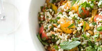 """<p>Tabbouleh is a Middle Eastern salad typically made with bulgur (dried and ground or crushed wheat berries that are parboiled). Here, warm brown rice takes bulgur's place. You can serve the bright, colorful salad with pita wedges for a starter.<br /><strong>Recipe:</strong> <a href=""""../../../recipefinder/nutty-brown-rice-tabbouleh-recipe-fw1010"""" target=""""_blank""""><strong>Nutty Brown-Rice Tabbouleh</strong></a></p>"""