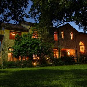 "<b>Location:</b> Castle Hills, TX<br /> <b>In a Past Life:</b> Mansion<br /><br /> Chester A. Slimp and his family completed construction of their gorgeous ""Castle on the Hill"" in 1931. The two-story, four-bedroom, three-and-a-half-bath residence covered just a small portion of the family's 44 acres. Today the structure rests on the 2 1/2 acres that remain exclusive to the estate. In 2001, Jason Dady, then a recent culinary school graduate, purchased the property with his wife, Crystal, and brother, Jake. The three have turned the space into an American <a href=""http://www.thelodgerestaurant.com/"" target=""_blank"">restaurant</a>. The external and internal structures remain mostly in tact. In fact, the upstairs was never converted into a single open space — the bedrooms and sun room are now private dining spaces."