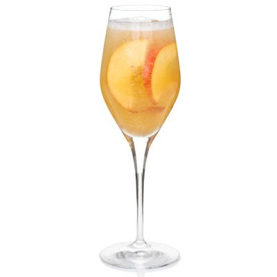<p>Non-alcoholic sparkling white wine and peach nectar pair wonderfully in a champagne glass.</p><br />