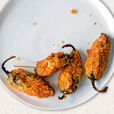 "<p>Spicy jalapenos are stuffed with cheese, then rolled in cornmeal and deep-fried to make these addictive snacks.</p><br /> <p><b>Recipe:</b> <a href=""/recipefinder/jalapeno-poppers-recipe-opr0211"" target=""_blank""><b>Jalapeño Poppers</b></a></p>"