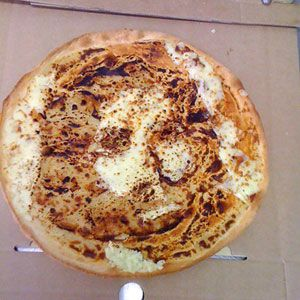 "<b>Food:</b> Pizza<br /> <b>Looks Like:</b> Jesus<br /><br />  Australia's Posh Pizza received considerably more than their typical asking price for a pizza after this pie came out of the oven. The ""Cheesus Pizza"" was sold for $153 (Australian; roughly $160 US), which the shop intended to donate to charity.<br /><br />  <a href=""/recipes/cooking-recipes/martha-stewart-pizza""><b>Learn how to make pizza at home.</b></a>"