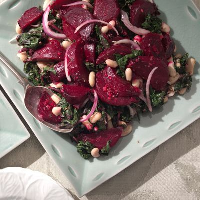"<p>Sometimes beets in the market have beautiful, unblemished, tender greens attached. When that happens, blanch the greens and toss with beans and vinaigrette, using some of the beets to garnish the salad, as in this recipe. Use the leftover cooked beets for other dishes. If you buy beet greens on their own, you can make the salad just with them.</p><br /><p><b>Recipe: </b><a href=""/recipefinder/beets-greens-salad-cannellini-beans-recipe-4162"" target=""_blank""><b>Beets and Greens Salad with Cannellini Beans</b></a></p>"