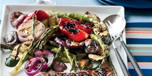 """Grill up this colorful mix of fresh vegetables and delicious porterhouse steak over a hot charcoal grill for smoky flavor. <br /><br /> <b>Recipe: <a href=""""/recipefinder/grilled-porterhouse-steak-summer-vegetables-recipe""""target=""""_new"""">Grilled Porterhouse Steak with Summer Vegetables</a></b>"""