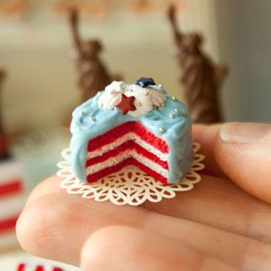 """<b>The Artist:</b> Caroline McFarlane-Watts, <a href=""""http://hummingbirdminiatures.blogspot.com/"""" target=""""_blank"""">Hummingbird Miniatures</a><br /><br />  This patriotic cake isn't edible (it's made out of polymer clay), but it sure looks good enough to eat. Miniature artist Caroline McFarlane-Watts started making and selling her mini creations to other kids on the playground when she was young. Today she has some decidedly bigger clients. Have you seen <i>Harry Potter and the Order of the Phoenix</i>? Then you've seen McFarlane-Watts' work. She created the scale model of Hogsmeade Village for the movie.<br /><br />  Want to purchase an original Hummingbird Miniature mini food? Check out this shop on <a href=""""http://www.etsy.com/shop/hummingbirdminiature"""" target=""""_blank"""">etsy.com</a>."""