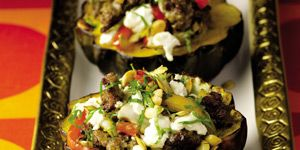 """<p>This all-in-one dish will wow your guests.  If you can, make the turkey sausage one day ahead for a bolder flavor.</p><p><strong>Recipe:</strong> <a href=""""http://www.delish.com/recipefinder/guy-fieri-roasted-acorn-squash-turkey-sausage-peppers-goat-cheese-recipe""""><strong>Guy Fieri's Roasted Acorn Squash with Turkey Sausage, Peppers, and Goat Cheese</strong></a></p>"""