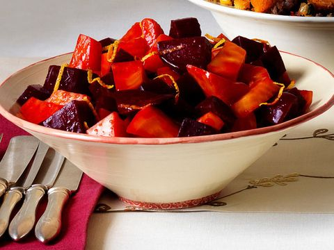 """Add some color to your Thanksgiving table with a bowl of delicious red and golden beets. <br /><br /> <a href=""""http://www.redbookmag.com/recipefinder/warm-sweet-and-sour-orange-beets-recipe"""">Get the recipe!</a>"""