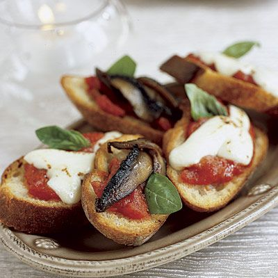 """<p>A great addition to any party menu, these garlic-rubbed toasts boast marinara sauce and any combination of toppings that appeal, such as fresh mozzarella, fresh basil, portobello mushrooms, prosciutto, and roasted red peppers.</p><br /><p><b>Recipe: <a href=""""/recipefinder/bruschetta-recipe"""" target=""""_blank"""">Bruschetta</a></b></p>"""