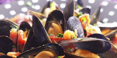 """With fresh mussels increasingly available at supermarket fish counters, you can easily make this bistro favorite at home.<br /><br /><b>Recipe:</b> <a href=""""/recipefinder/steamed-mussels-in-tomato-broth-recipe-5702""""target=""""_blank"""">Steamed Mussels in Tomato Broth</a>"""