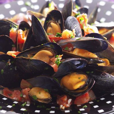 "With fresh mussels increasingly available at supermarket fish counters, you can easily make this bistro favorite at home.<br /><br /><b>Recipe:</b> <a href=""/recipefinder/steamed-mussels-in-tomato-broth-recipe-5702""target=""_blank"">Steamed Mussels in Tomato Broth</a>"