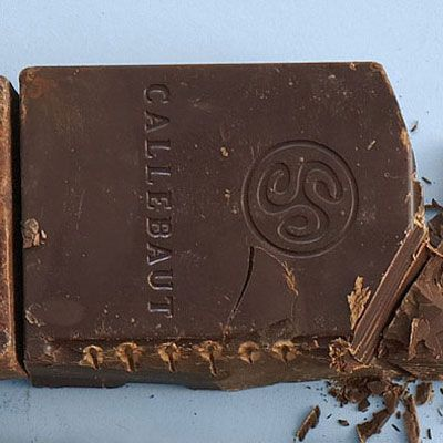 """<p>This bitter bar is 100 percent cacao (entirely derived from the cocoa bean) with no added sugar. It's used primarily for baking, and is generally considered too harsh and """"chalky"""" tasting for plain old eating.</p><br /> <p><a href=""""http://www.delish.com/search/fast_search_recipes/?search_term=Unsweetened%20Chocolate""""target=""""_new"""">Get recipes that use unsweetened chocolate</a></p>"""