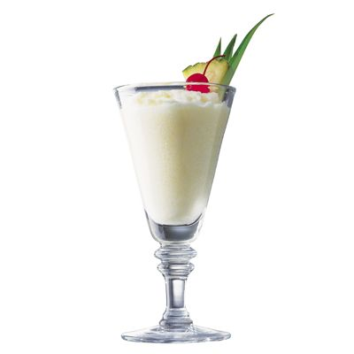 """<p>The king of all tropical frozen drinks, this pineapple-crowned piña colada is best enjoyed outside in the sun. And thanks to a short list of ingredients, this drink can be ready in minutes.</p><br /><p><b>Recipe: <a href=""""/recipefinder/pina-colada-drinks-cocktails"""" target=""""_blank"""">Piña Colada</a></b></p>"""